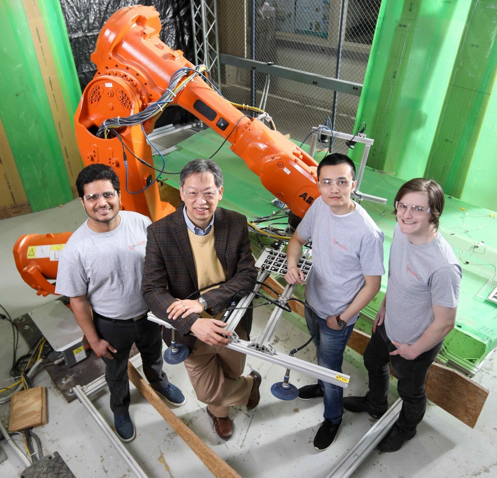 John Wen, Students, and Staff with Industrial Robot