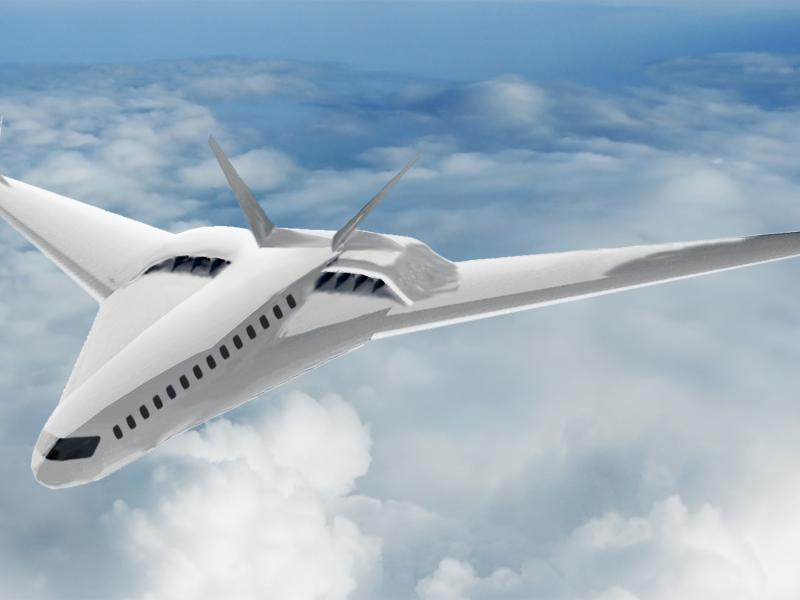 A sleek white aircraft flies above white clouds.